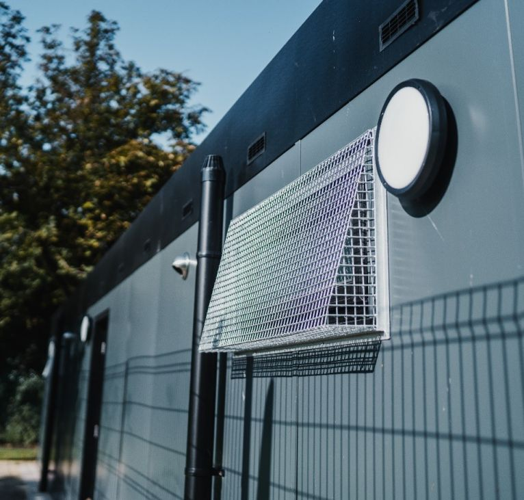 Modular changing facilities window with cage