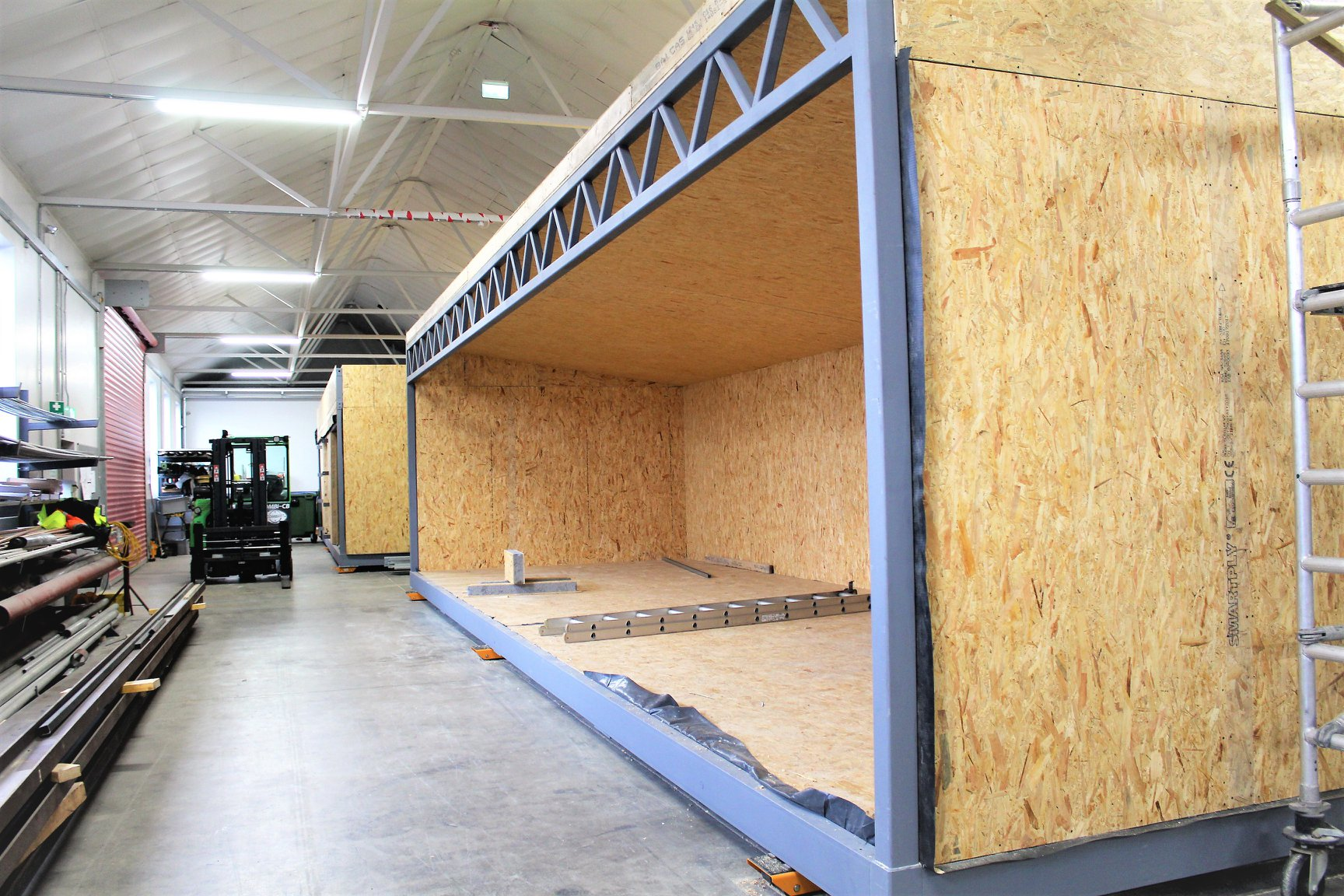 Structurally Insulated Panels (SIP Panels) are a high-performance building material used in the construction of SmartBuild modular buildings.