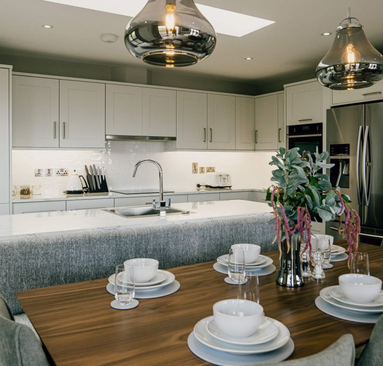 open plan kitchen living turnkey package lights dinning area plates